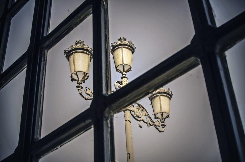 Streetlight through the window of a restaurant in seville, andalusia, spain