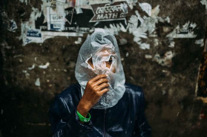 Ideas are Water Proof Close-up Cold Temperature Day Human Hand Men Monsoon One Person Outdoors People Plastic Bag Portrait Rain Rainy Days Real People