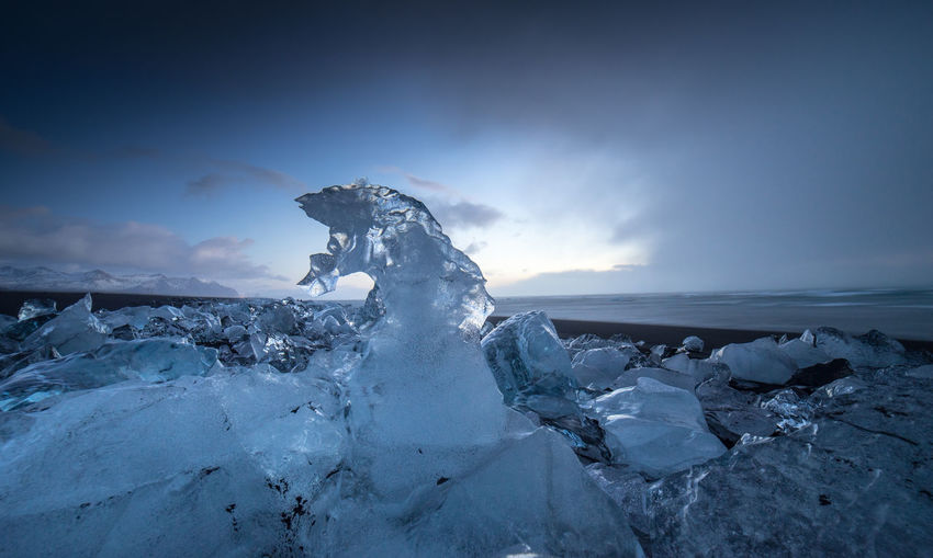 Scenic view of frozen sea against sky during winter