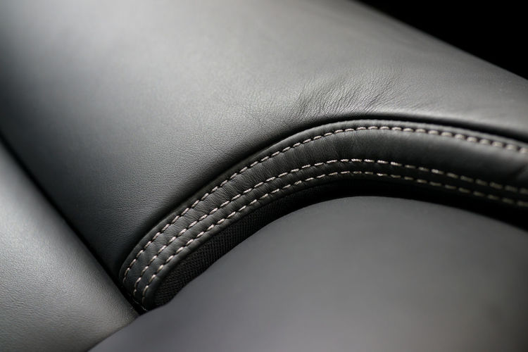 Close up part of premium leather car seat background Grey Blackandwhite Dark Material Smooth Skin Modern Soft Industry Comfort Craftwork Furnishing Quality Premium Luxury Technology Security Safety Textured  Fastening Protection Connection No People Leather Vehicle Interior Car Interior Car Transportation Mode Of Transportation Indoors  Motor Vehicle Studio Shot Close-up Stiching