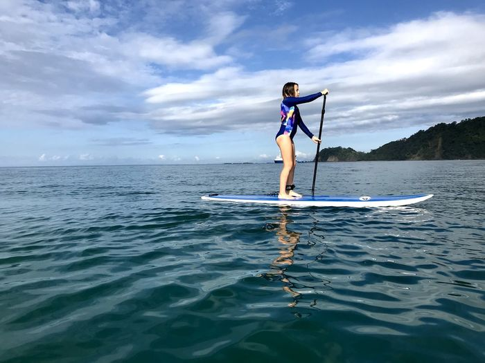 Water Sea One Person Cloud - Sky Sky Sport Lifestyles Real People Beauty In Nature Leisure Activity Waterfront Nature Paddleboarding Day Scenics - Nature Horizon Over Water Transportation Full Length Outdoors