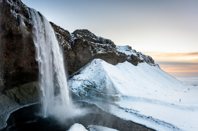 Iceland Iceland Wintertime Beauty In Nature Scenics - Nature Water Waterfall Sky Nature Rock Tranquil Scene Motion Mountain Long Exposure Non-urban Scene Snow Rock - Object Environment Cold Temperature Tranquility Solid No People Outdoors Flowing Water Power In Nature Flowing Snowcapped Mountain