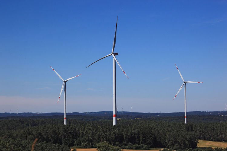 Wind generators, Windmills in the landscape Wind Energy Wind Turbine Windmill Windmills Alternative Energy Blue Environment Environmental Conservation Fuel And Power Generation Generator Land Landscape Nature No People Outdoors Renewable Energy Sky Sustainable Resources Technology Turbine Wind Power Wind Turbine