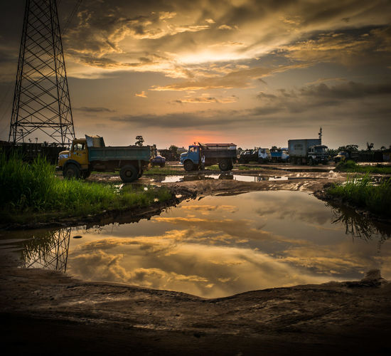 Africa Africa Day To Day Africa Today By The Road Cloud - Sky Clouds And Sky EyeEmNewHere Flooding Harmattan Mode Of Transport Monsoon Moody Sky Nature Nigeria Rainy Days Rainy Season Reflection Sunset Transportation Trucks Water Reflections