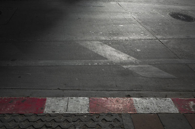 Sign Symbol Road Road Marking Street Marking High Angle View Day City No People Footpath Transportation Pattern Outdoors Architecture Sidewalk Crosswalk Direction Guidance Red Concrete Dividing Line