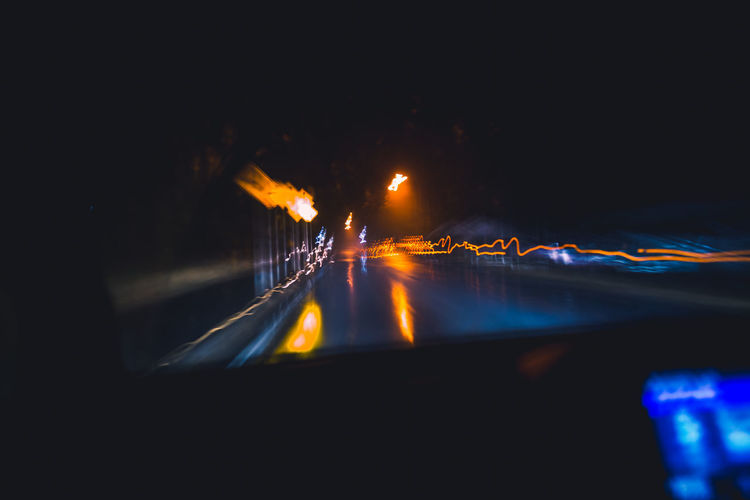 Technology Tech Rain Drive Driving Night Night Lights Neon Dark Lights The Glitch Abstract POV Algorithm Analytics Speed Revolution Through The Window Light And Shadow Humanity Meets Technology My Best Photo Illuminated Road Road Trip Transportation Motion Mode Of Transportation Car Motor Vehicle Nature Long Exposure No People Blurred Motion on the move Outdoors City Water Street Sign Light Trail Blur