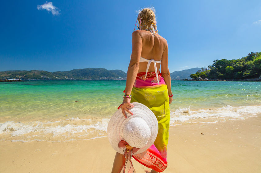 Back of happy and fashionable tourist woman with colorful sarong in turquoise water of Maya Bay famous lagoon of The Beach movie, Phi Phi Leh, Andaman Sea in Thailand Fashionable and happy tourist with sarong and pink wide-brimmed hat making a selfie on tropical famous beach of Nai Harn Beach, Rawai, Phuket, Thailand. Happy tourist enjoys panorama from Sail Rock View Point of kor 8 of Similan Islands National Park, Phang Nga, Thailand, one of the tourist attraction of the Andaman Sea. Happy woman with bikini and shorts, jumping in the air on Ya Nui Beach, a little cove divided by a rocky cape, Phuket, Thailand, Asia. Happy Koh Rok Islands Nui Beach Phang Nga Bay Phuket Thailand Tanning ☀ Thailand Vacations Woman Beach Beautiful Woman Beauty In Nature Bikini Day Girl Horizon Over Water Koh Rok Leisure Activity Lifestyles Nature One Person Outdoors Phang Nga Rawai Real People Rear View Sand Scenics Sea Seascape Shirtless Shore Sky Standing Sunlight Surin Islands Travel Destinations Vacations Water Young Adult Young Women