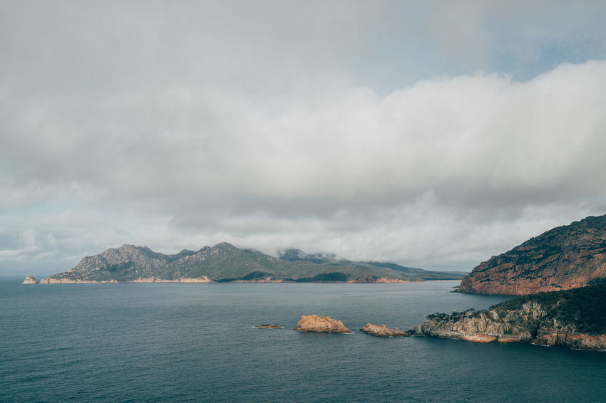 Looking back at Freycinet National Park from Cape Tourvile Australia Australian Coles Bay Tasmanian Beauty In Nature Cape Tourville Cloud - Sky Day Freycinet Freycinet National Park Mountain Mountain Range Nature No People Outdoors Scenics Sea Sky Tasmania Tassie Tranquil Scene Tranquility Water Waterfront