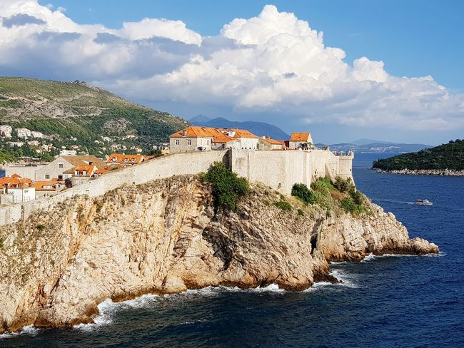 Walls of Dubrovnik Cloud - Sky Rocky Cliffs EyeEm Selects Island Lokrum  Dubrovnik Croatia Cliff Rock - Object Adriatic Sea Wall Sea Mountain Beach Water Sand Summer History House Sky Architecture Fort Fortified Wall Town TOWNSCAPE
