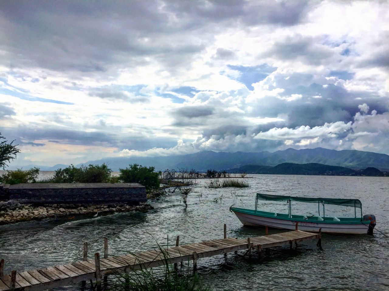 water, sky, cloud - sky, scenics, tranquility, nature, nautical vessel, no people, beauty in nature, outdoors, tranquil scene, day, transportation, moored, mountain, lake, tree