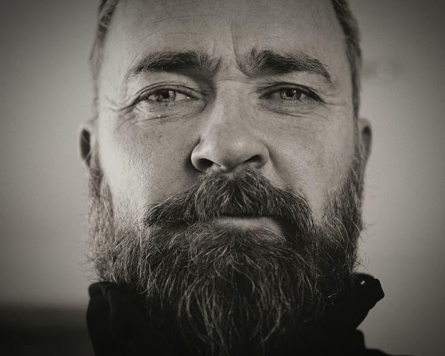 Close-Up Portrait Of Mature Man In Beard