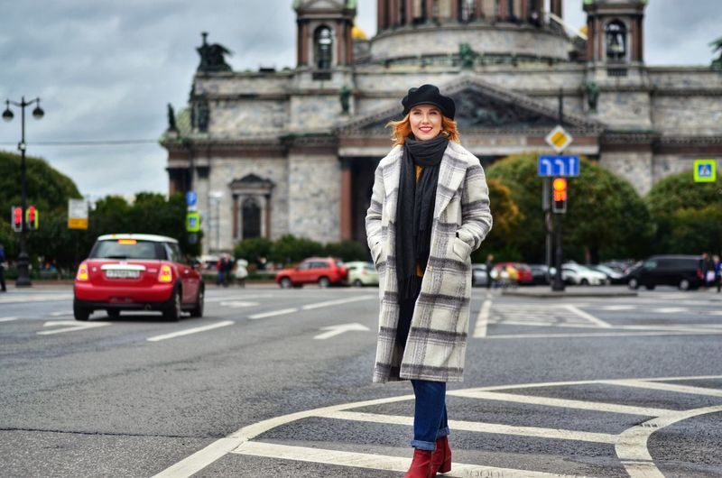 Young woman walking on street in city
