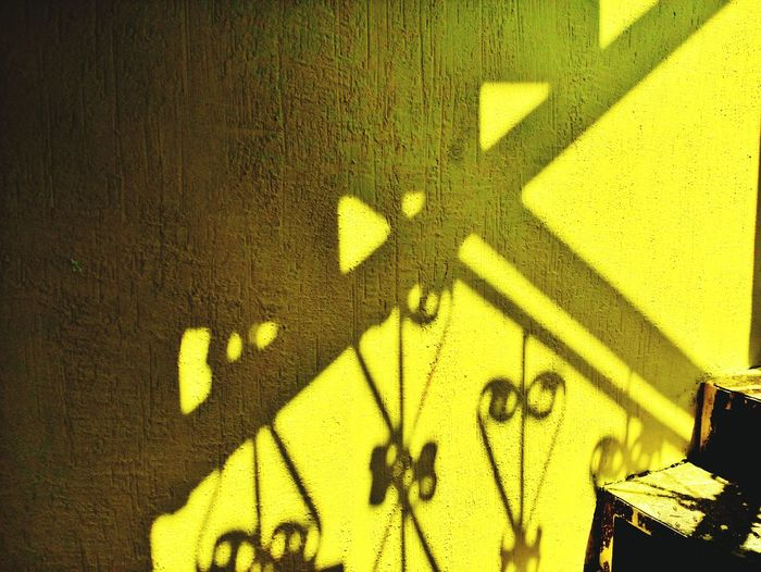 Paint The Town Yellow Shadow Sunlight Focus On Shadow Yellow No People Outdoors Yellow Background Colored Background Mobilephotography Residential Building Mobile Photography Architecture Textured  Sunlight MotoE