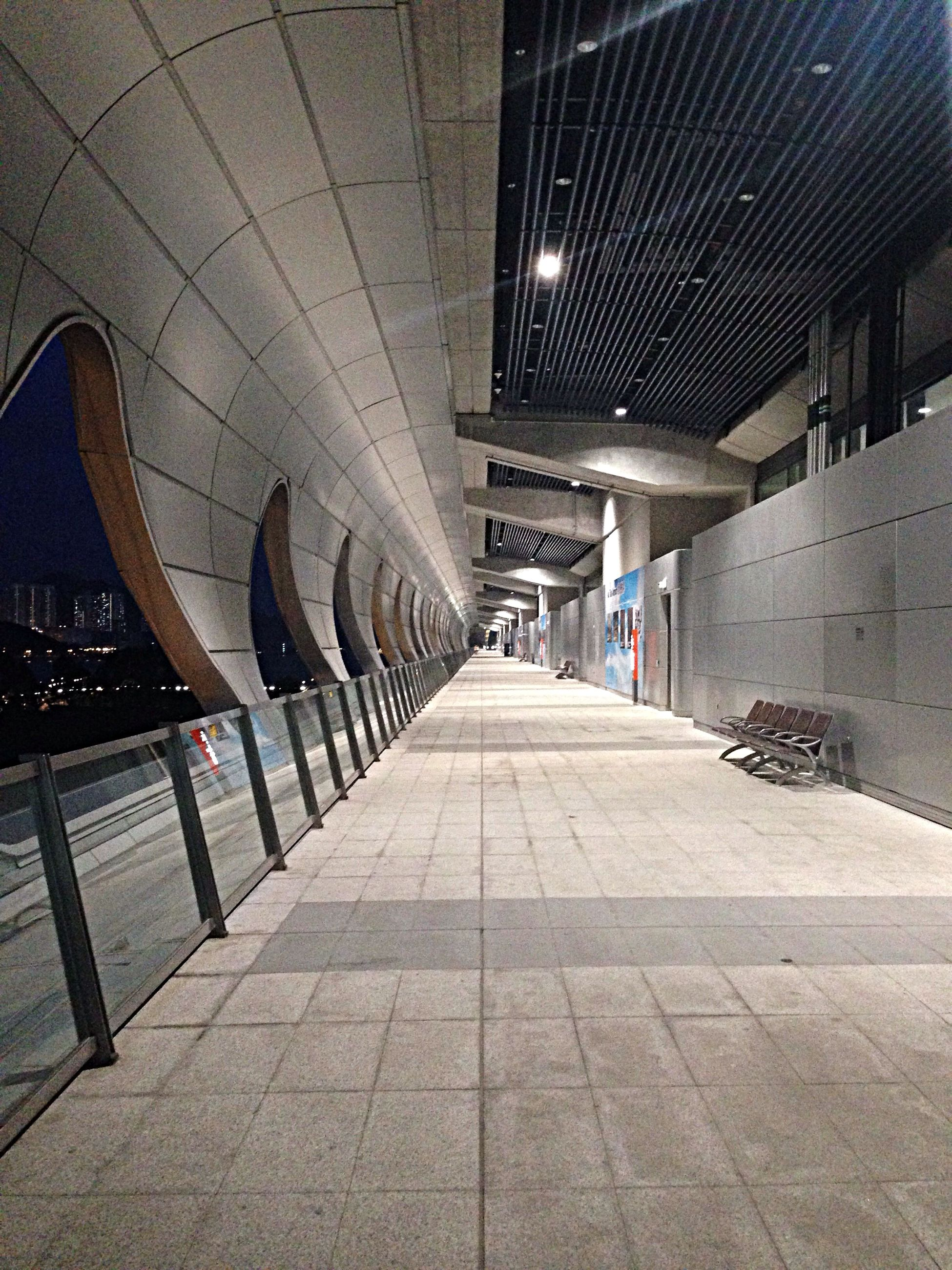 the way forward, architecture, built structure, diminishing perspective, illuminated, building exterior, walking, full length, ceiling, vanishing point, walkway, indoors, men, city, lighting equipment, tiled floor, cobblestone, lifestyles