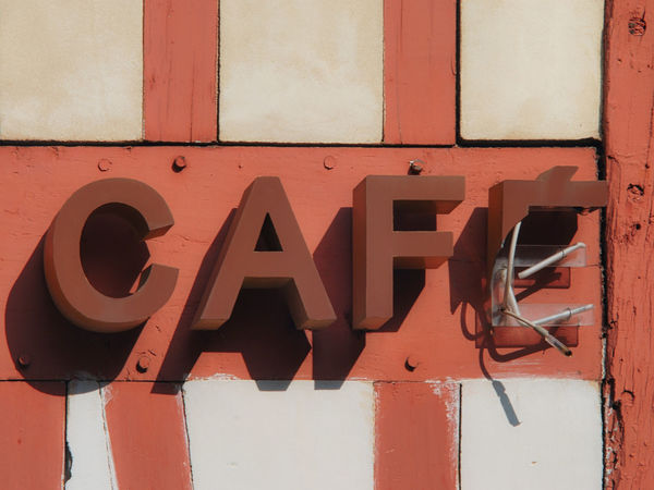 """Broken coffee """"café"""" sign in France. Coffee France Wood Alphabet Architecture Black Color Building Exterior Built Structure Cafe Cafe Time Capital Letter Close-up Communication Day Low Angle View Metal No People Outdoors Red Sign Sunlight Text Wall - Building Feature Western Script Wooden"""