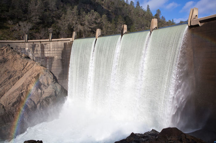 Water spills over the dam of Lake Clementine in California. Architecture Built Structure Concrete Dam Day Environment Flood Flowing Water Lake Motion Nature No People Outdoors Power In Nature Rainbow Reservoir River Spillway Water Waterfall