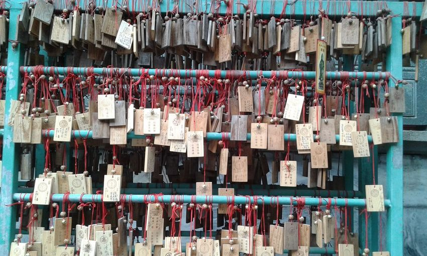 Close-up of prayer blocks hanging outdoors