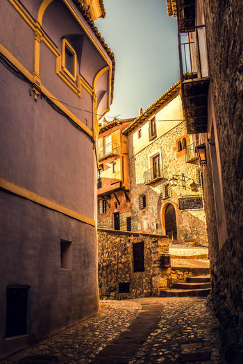 Alley amidst old buildings in city