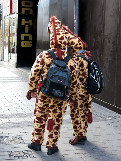 Carnival in Cologne Adult Adults Only Animals Carnival Crowds And Details City Day Disguised Full Length Giraffes Human Body Part Lifestyles Navgation Communication outdoors People Real People Standing Togetherness Friends ❤ Backpacker Animallovers Beast Of Burden