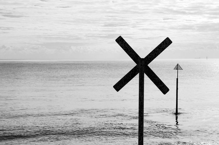 Signs Of The Sea Black & White Sign Signs Beach Blackandwhite Day Horizon Over Water Nature No People Outdoors Scenics Sea Sky Tranquil Scene Tranquility Water