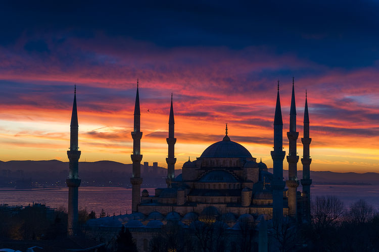 Blue Mosque Against Dramatic Sky During Sunset