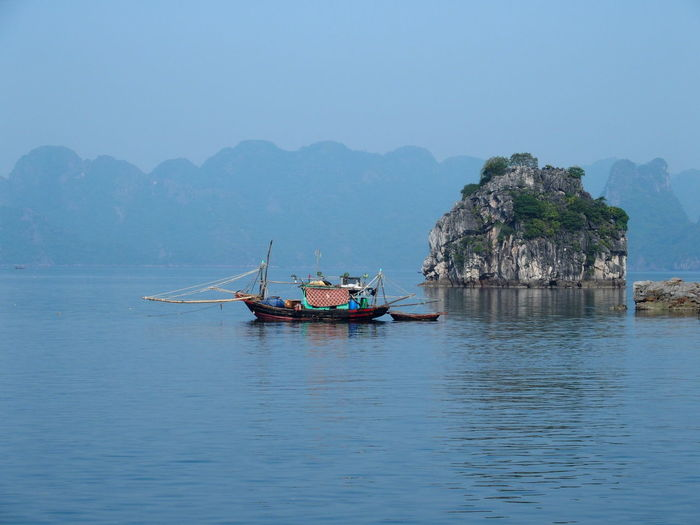 Boats Moored At Halong Bay In Foggy Weather