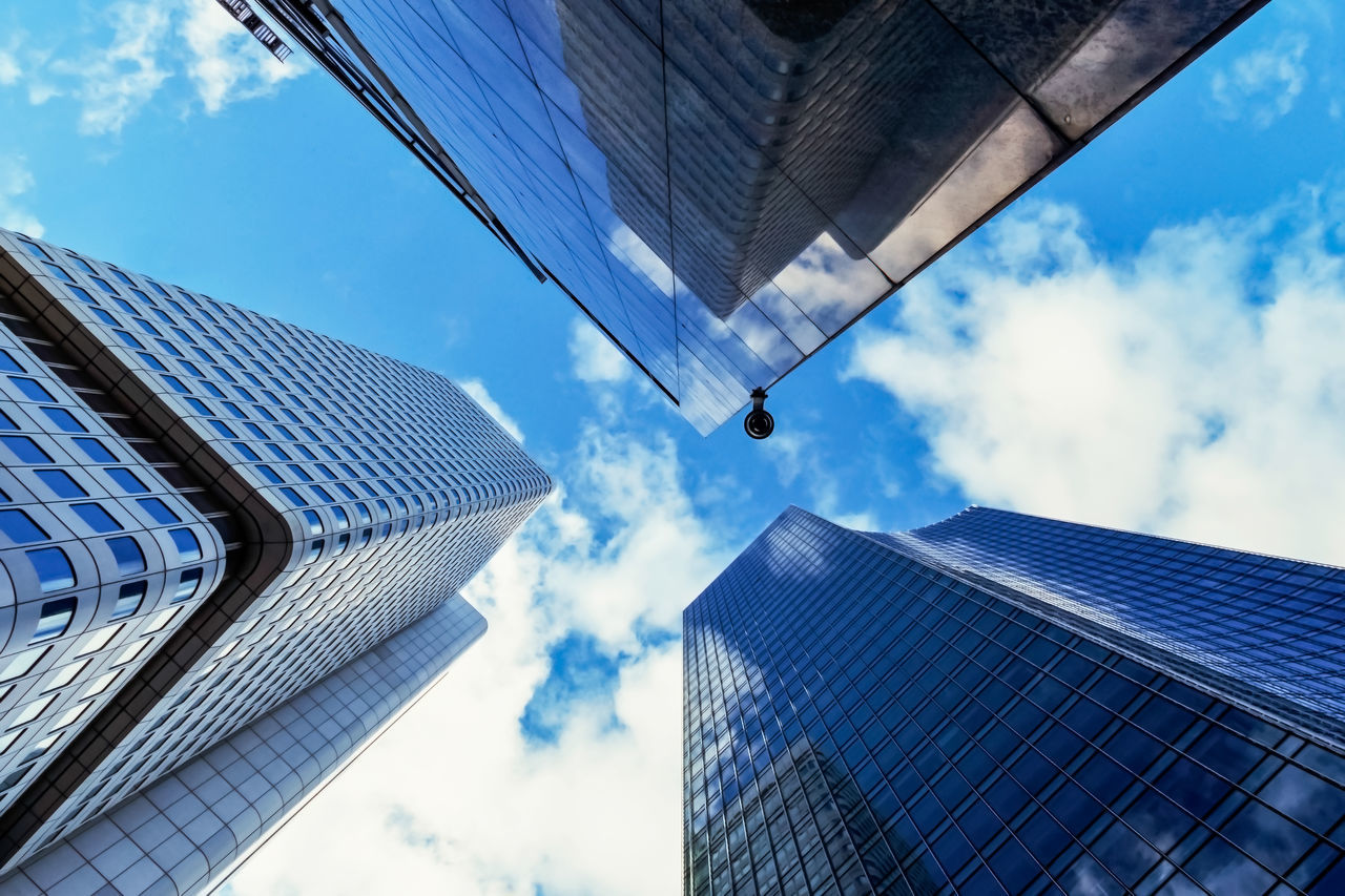 architecture, skyscraper, sky, building exterior, built structure, modern, low angle view, city, cloud - sky, tall, blue, tower, growth, day, outdoors, no people, office park