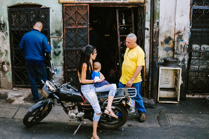 Catia, Caracas Group Of People Men Full Length Real People Child Males  Women Adult Childhood Parent Females Family People Father Architecture Mother Daughter Casual Clothing Lifestyles Son Mature Men Outdoors Street Photography EyeEm Selects EyeEm Best Shots The Art Of Street Photography The Street Photographer - 2019 EyeEm Awards
