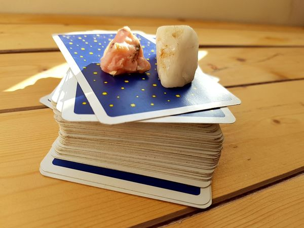 a tarot deck Bude Cornwall Tarot Tarotcards Deck Deck Of Cards Indoors  Wood - Material Food And Drink Table Sweet Food No People Food Close-up Day