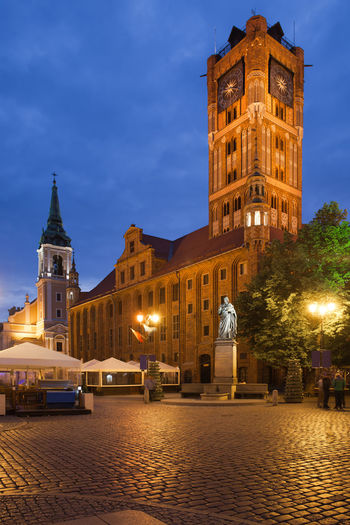 Old City Town Hall on Main Market Square in Torun, Poland at night, Gothic architecture dating back to 13th century. City Hall Old Town Poland Square Toruń Travel Architecture Building Building Exterior Built Structure City Clock Tower Dusk Europe History Illuminated Landmark Medieval Monument Night No People Old Town Square Tower Town Hall Travel Destinations