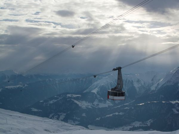 Beauty In Nature Cable Cloud - Sky Cold Temperature Connection Day Electricity Pylon Landscape Mountain Nature No People Outdoors Overhead Cable Car Power Line  Ski Holiday Ski Lift Sky Snow Snowcapped Mountain Transportation Weather Winter