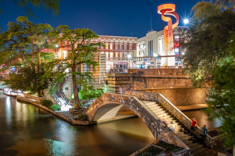 Built Structure Architecture Water Building Exterior Bridge Illuminated Bridge - Man Made Structure Connection Nature Transportation Tree Waterfront Building No People City Travel Destinations Plant Night Canal Arch Bridge San Antonio, Texas Riverwalk Downtown Travelling Tourist Attraction  Tourist Destination USA Place To Visit Things To Do Texas