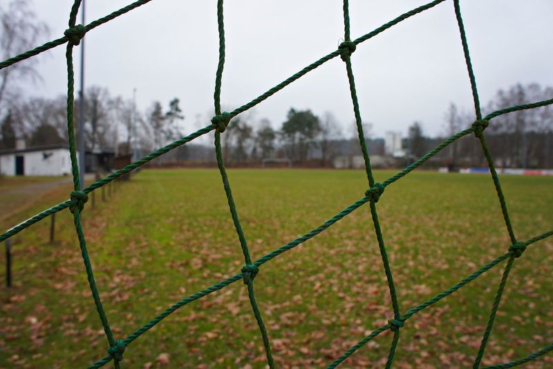 Close-up of soccer goal against sky