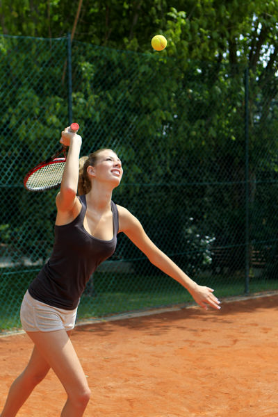 Young woman playing tennis, female tennis player Power Tennis Tennis Player Woman Young Active Activity Competition Court Famale Fit Fitness Leisure Leisure Activity One Person Outdoors Playing Pretty Sport Sports Tennis Ball Tennis Racket Vacation Young Adult