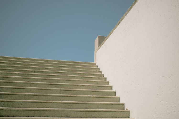 Low Angle View Of Empty Staircases Against Clear Blue Sky