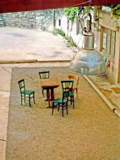 Bocci Court France Absence Architecture Beausoleil Bocci Built Structure Chair Day Electric Lamp Empty Focus On Foreground Glass - Material Hanging Land Light Bulb Lighting Equipment Nature No People Outdoors Sand Seat Table Transparent Travel Destinations