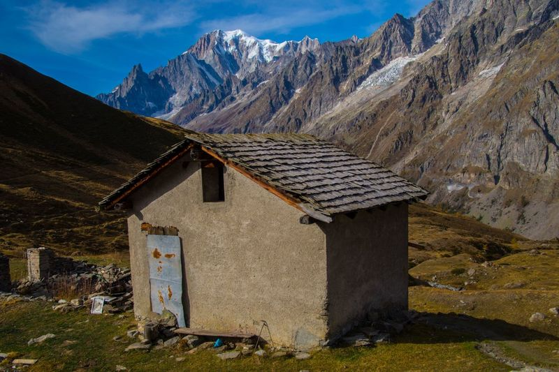 mallatra,val ferret,courmayeur,italy Mountain Mountain Range Architecture Sky Built Structure No People Building Landscape Nature Scenics - Nature Day Cloud - Sky Environment Solid Building Exterior Land Hut House Beauty In Nature Travel Destinations Outdoors Snowcapped Mountain