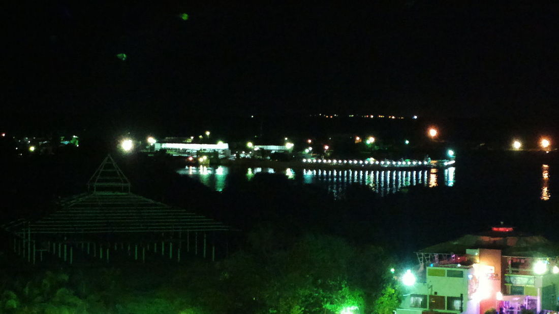 I love this picture. It is really romantic. This place was once used to conduct weddings near the Maracaibo Lake (Lago de Maracaibo). Night Beaty Architecture Building Exterior Built Structure City Illuminated Lago De Maracaibo Night No People Outdoors Over The Lake Sky Tree