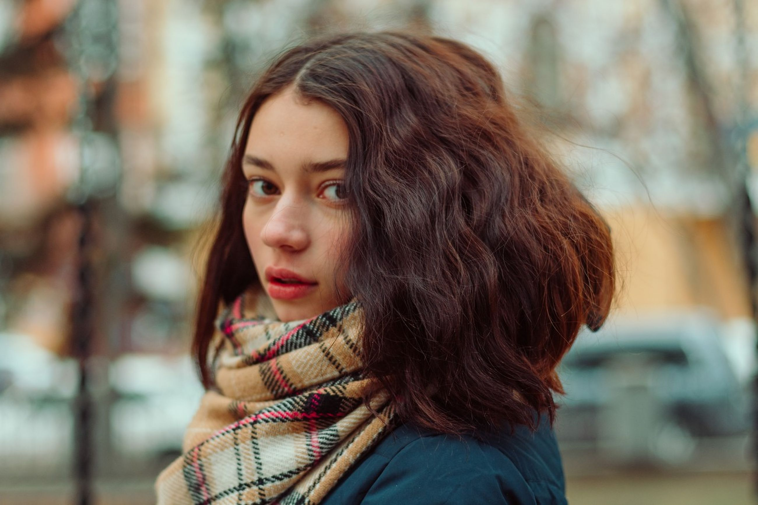 portrait, headshot, focus on foreground, one person, hairstyle, hair, brown hair, women, long hair, real people, looking, looking away, young adult, leisure activity, beautiful woman, day, lifestyles, beauty, young women, outdoors, contemplation, warm clothing, scarf