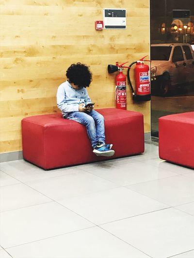 Boy Texting Boy Alone New Generation And Media One Person Boy Sitting On The Chair Boy Sitting Alone