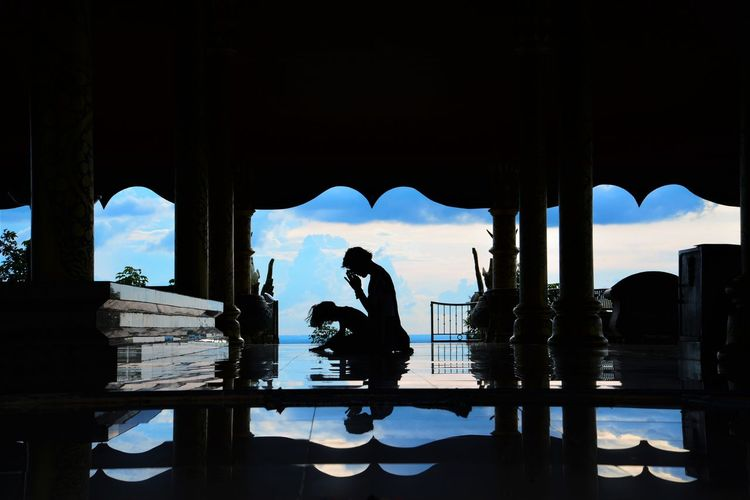 Thailand Temple photos . back light. My Best Travel Photo Thailand Photos Adult Architectural Column Architecture Built Structure Day Leisure Activity Lifestyles Men Nature One Person Outdoors Real People Reflection Silhouette Sitting Sky Temple Temple Thailand Thailand_allshots Thailandtravel Water Waterfront Women