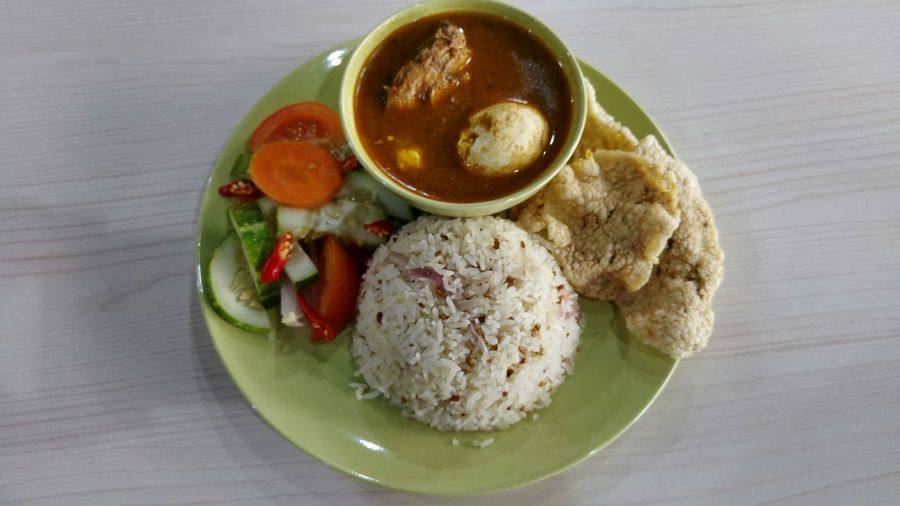 Nasi dagang, a traditional East Asia dish consisting of rice steamed in coconut milk, fish curry and extra ingredients such as hard boiled egg and vegetable pickles. Rice, Curry, Food, Traditional, Asia, Malaysia, Dishes, Delicious First Eyeem Photo