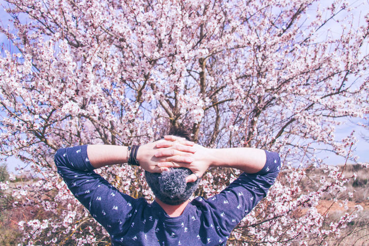 Full length of woman on cherry blossom