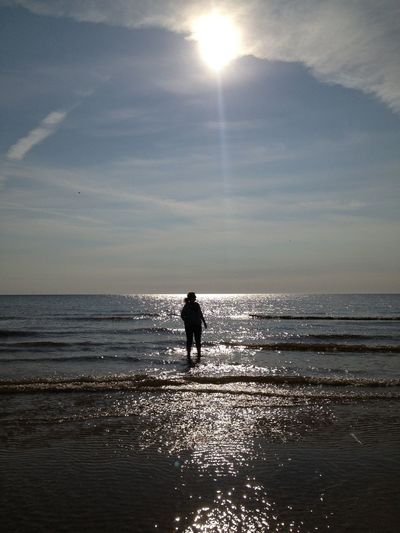 Silhouette Of Man Standing In Sea