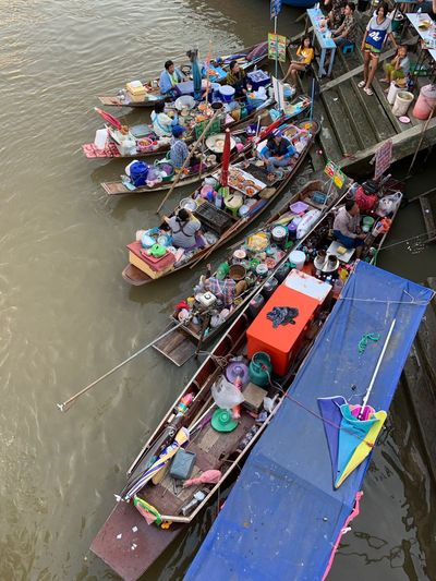 High angle view of people in boats on river at floating market