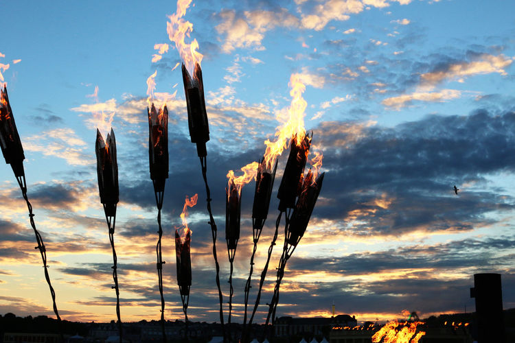 Atmosphere Atmospheric Mood Beauty In Nature Burning Fire Metal Dramatic Lighting Fireball Flame Flames Glowing Illuminated Torches Torchlight Light Night No Limits Orange Color Standing Sunset Lanterns Medieval Sunsets Lit Bonfire Night