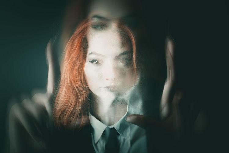 Digital composite image of girl in darkroom