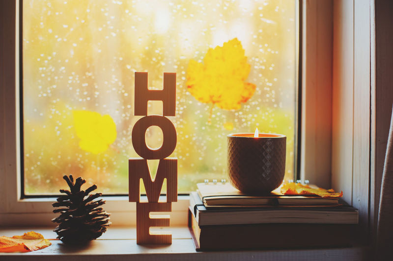 cozy autumn morning at home. Hot tea and candle on window in rainy cold day. Spending holidays at home. Cozy Autumn Morning Home Window Rain Rainy Days Candle Hygge Lagom Homely Tea Lemon Drink Calm Weekend Lifestyles Leaves