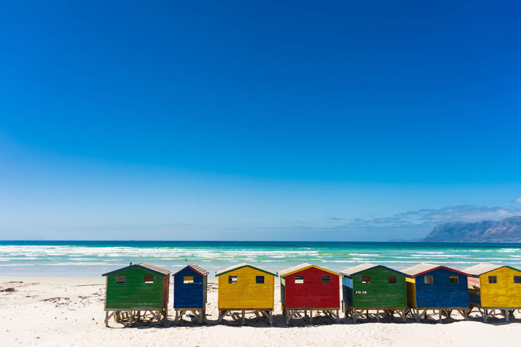 Beach huts against blue sky