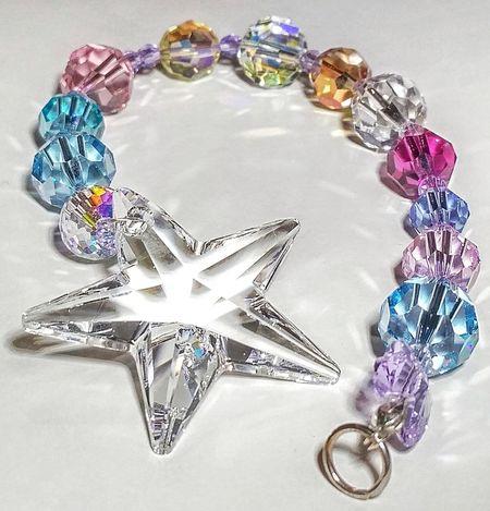 Crystal Illuminated Indoors  Gift Accessory Clear Star Rainbow SunCatcher  Swarovski Swarovski Crystals Dazzling Multi Coloured Sparkle Star Shape Close-up Ornament Design Handmade Decoration Hanging Multicolored Shine